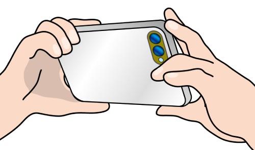 スマホでカメラをかまえているイラスト画像